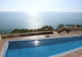 Spacious and sunny two bedroom apartment with views from every room to the sea